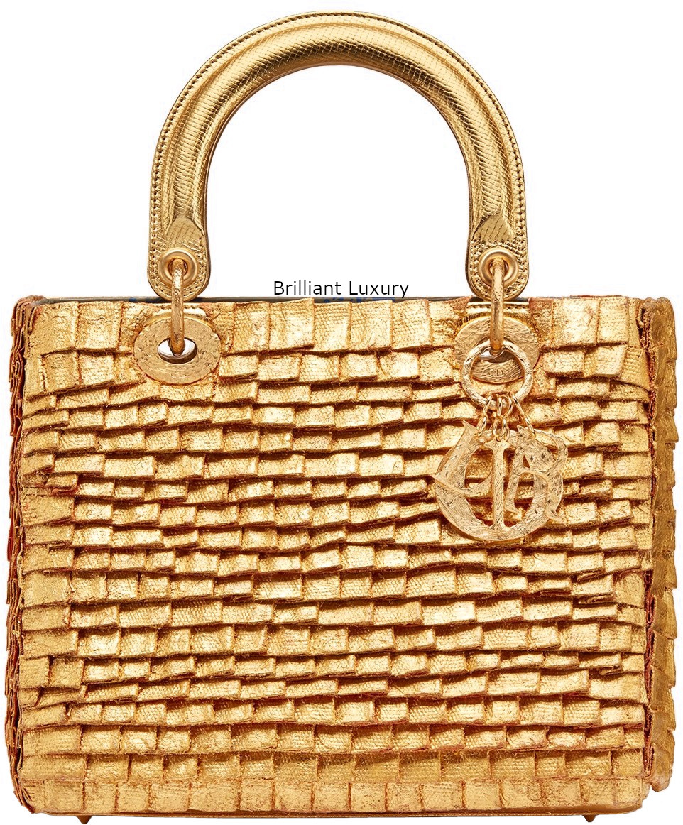 Lady Dior Art Bag embroidered cotton pieces covered with 24kt gold-hand-hammered and metal charms Designer Olga de Amaral