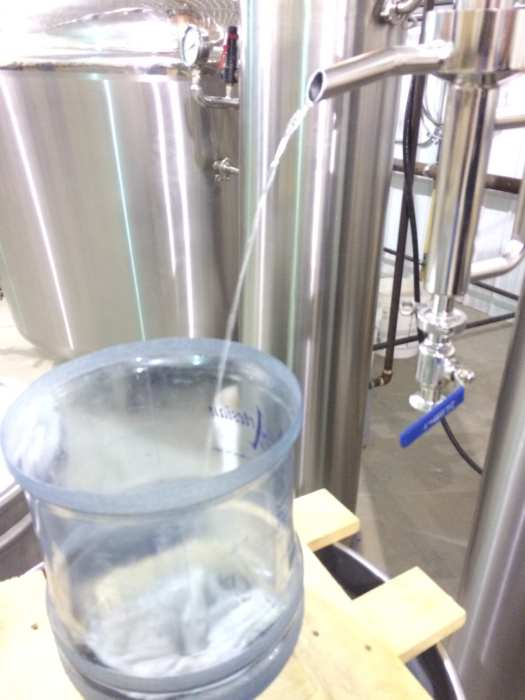 Fresh 175 proof corn whiskey coming out of the still. This will be diluted to 90 proof or less before being bottled.