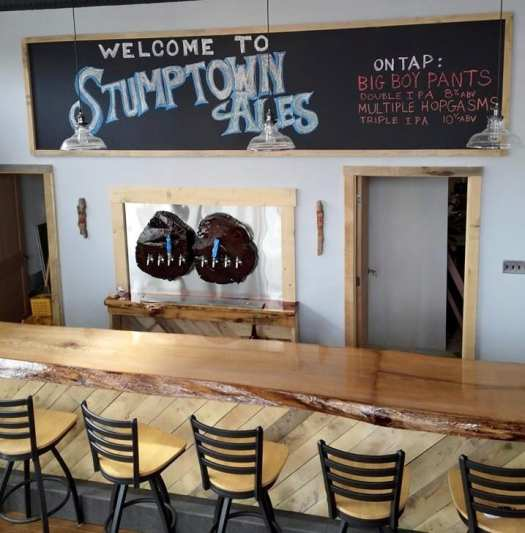 The brewery taproom features a 21-ft. solid oak log made into a bar.