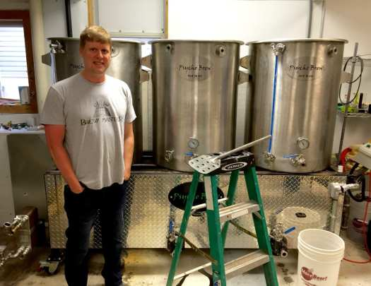 Robeson stands in front of his current 2.5 barrel brewing system.