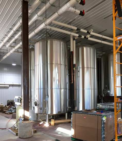 The ceiling plumbing (at top right) for is ready for the addition of another line of tanks as they are needed.