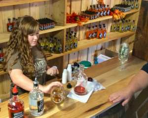 Small free samples are poured in the distillery tasting rooms.