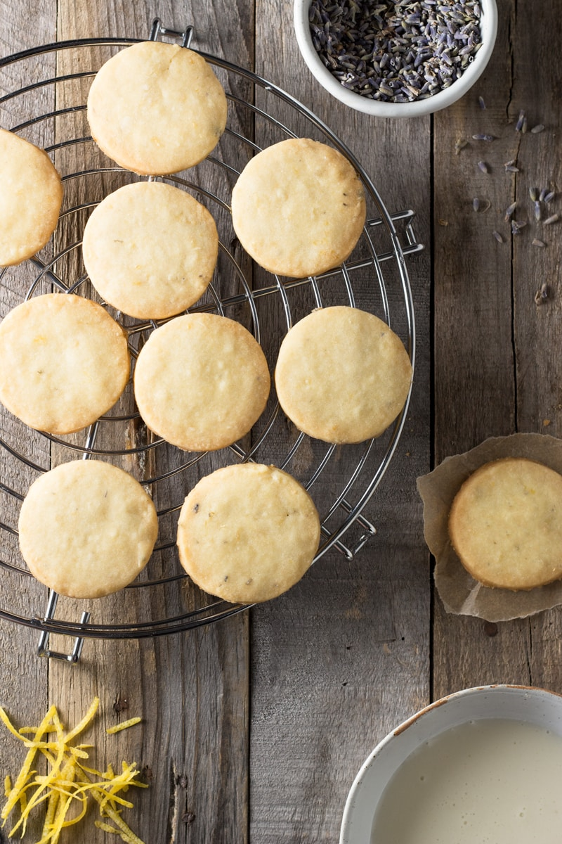 Lemon Lavender Shortbread Cookies on a cooling rack on a rustic wood surface.