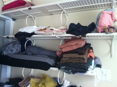 The old shelves, with most of the fabric gone. I got to keep the top two :)