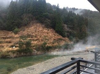 The view from our ryokan room window - the steam is rising from the sectioned off Sennin Buro