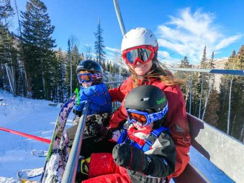 kids and mom on chairlift
