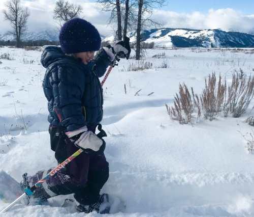 little girl snowshoing