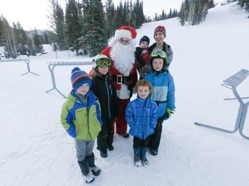 santa with kids and snow skiing