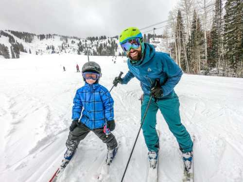man and boy skiing