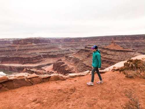 little girl hiking canyonlands