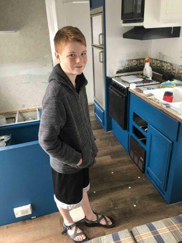 kid installing vinyl plank floors