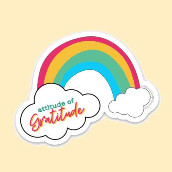 Rainbow sticker with clouds at the end with attitude of gratitude written in one of the clouds