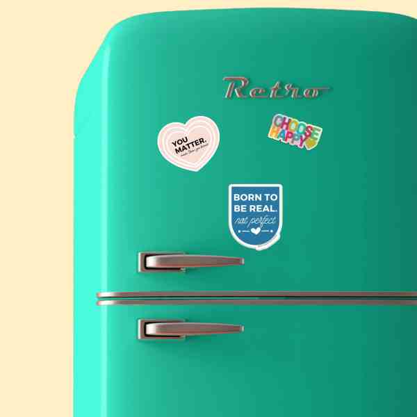 Teal fridge with stickers on it