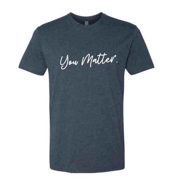 A tshirt in indigo blue with You Matter in white cursive font