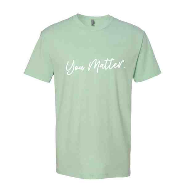 A tshirt in mint green with You Matter in white cursive font