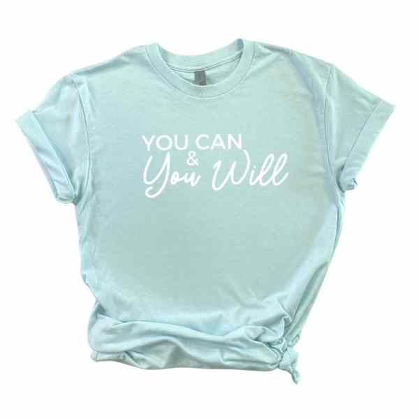 Light blue shirt with you can and you will written in white