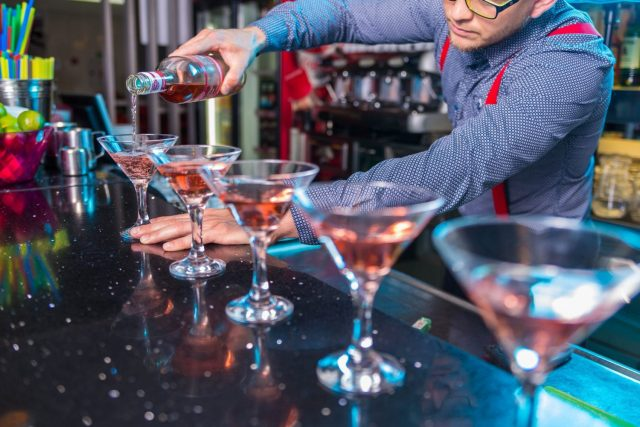 Bartender Pouring Glasses of Cocktails