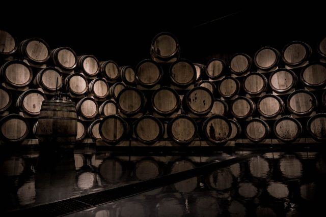 Whiskey Barrels Stacked in a dark room