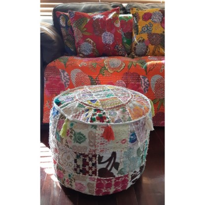 Patchwork embroidered foot stool in front of couch