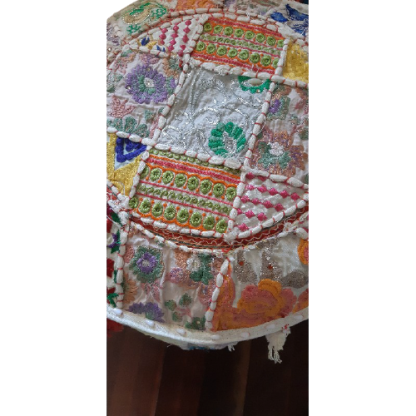 Embroidered patchwork ottoman close up