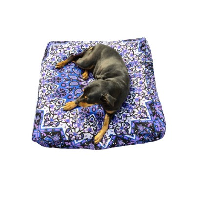 Boho dog bed purple colours with black dog laying on top