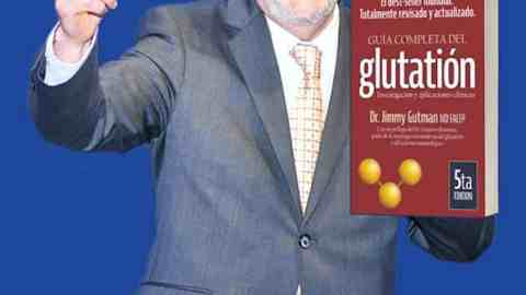 Picture of doctor Gutman holding his book