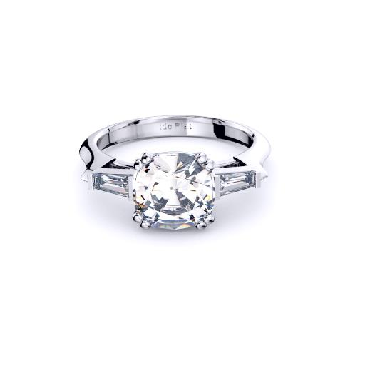 Image of three stone diamond engagement ring featuring cushion with tapered baguette diamond