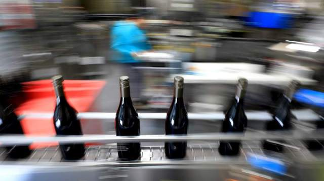 Bottling line in operation, April 2019. A recent outbreak of coronavirus cases in a Sonoma Valley winery has the health department looking at conditions and contacts. (Kent Porter / The Press Democrat)