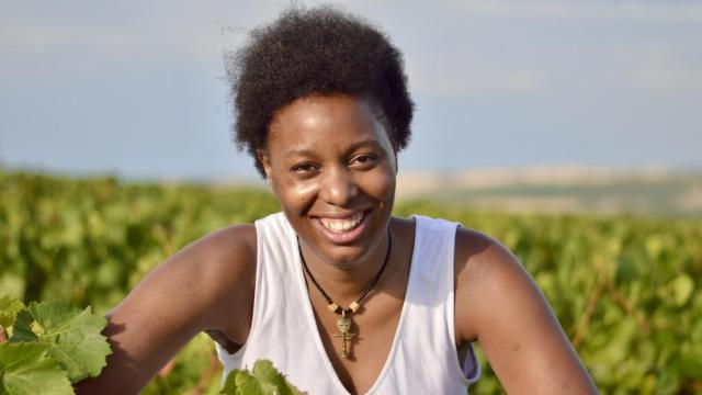 Jeanne Vito is an Afropean wine entrepreneur brought up in Chablis, working and living between South Africa, Togo and Germany. She has recently founded VINO VITO*, a Togo-based educational wine platform for West Africans. She made her first vintage in South Africa but she says her destiny brought her back into the land of her ancestors to grow vines. Portrait by Audrey Mariani.