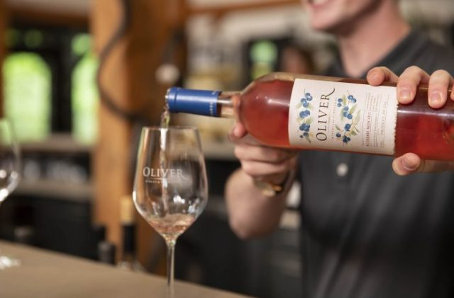 POURING BLUEBERRY MOSCATO AT OLIVER WINERY & VINEYARDS / PHOTO COURTESY OF OLIVER WINERY & VINEYARDS / TOD MARTENS