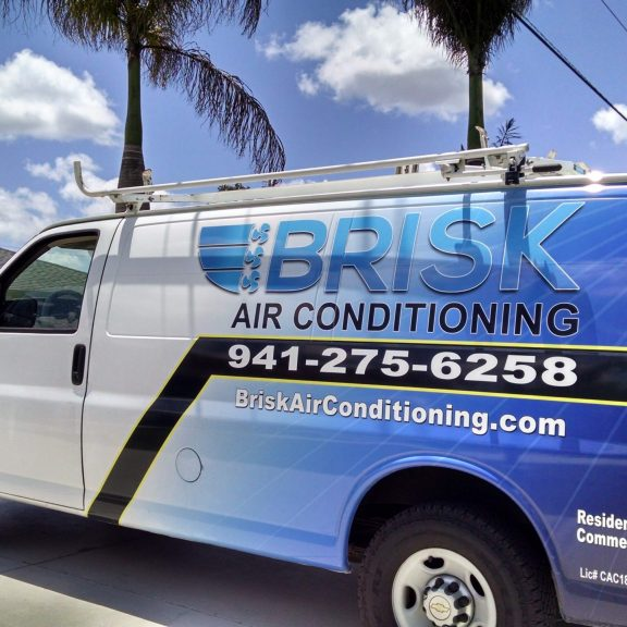 Van Making a Visit to Provide Brisk Air Conditioning's Annual Maintenance Program