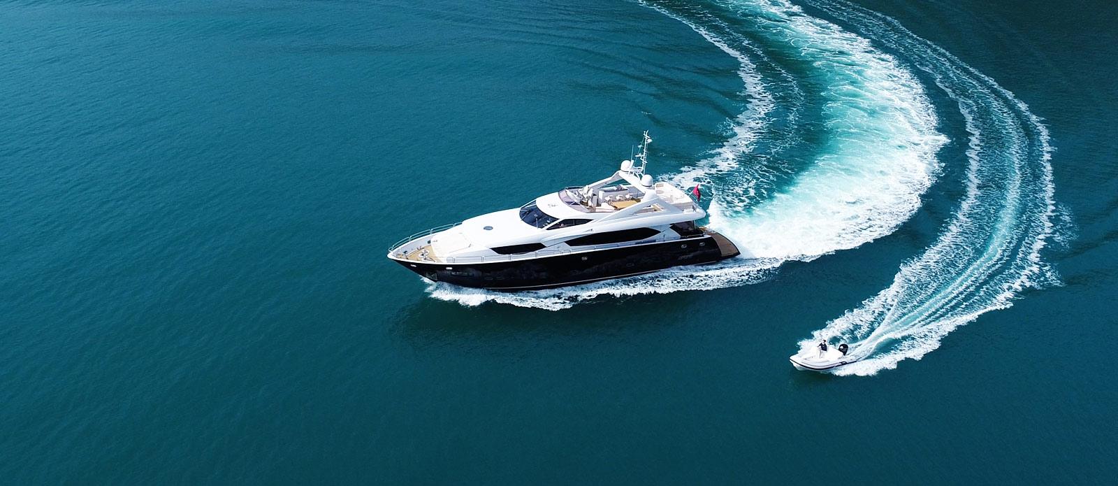 Sunseeker-30-Metre-Yacht-Coraysa-Cruising-with-Tender-Overhead