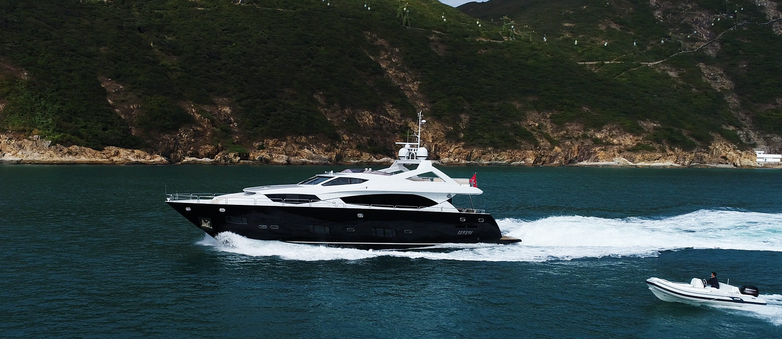 Sunseeker-30-Metre-Yacht-Coraysa-Cruising-with-Tender