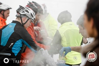 Riders tuck in to some welcome hot food