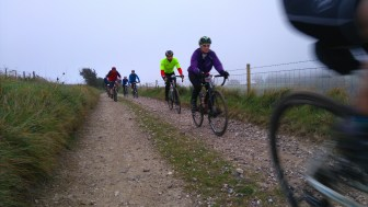 Luckier than me, riders heading down Flint Alley, puncture free