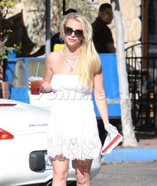 Britney Spears steps out in a white dress, showing off her trim figure while sipping Starbucks in Calabasas. December8, 2015 X17online.com