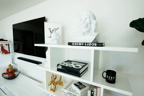 INTERIOR DESIGN STRIPES CONTEMPORARY HYPEBEAST COVETEUR CB2 WEST ELM ANTHROPOLOGIE MID CENTURY MODERN KELLY WEARSTLER LEATHER FRINGE BLACK MUDCLOTH MUD CLOTH POP ART