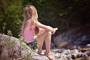 A reflective young girl. Identify PTSD symptoms in children and find expert EMDR counselors for preschoolers and young children. Brittani Persha Counseling in the Memorial Area of Houston, TX.