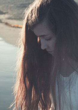 Picture of a depressed Teenager looking down. Brittani Persha Counseling offers therapy for teenagers suffering from anxiety, ADHD, PTSD, family difficulties, increased anger, isolation & more. Through family therapy we can help your teen reconnect. Serving the Memorial Area of Houston, TX with many clients from the Katy area.
