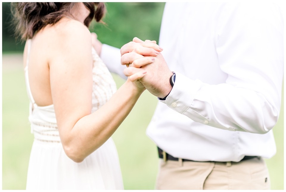 couple holding hands during engagement session