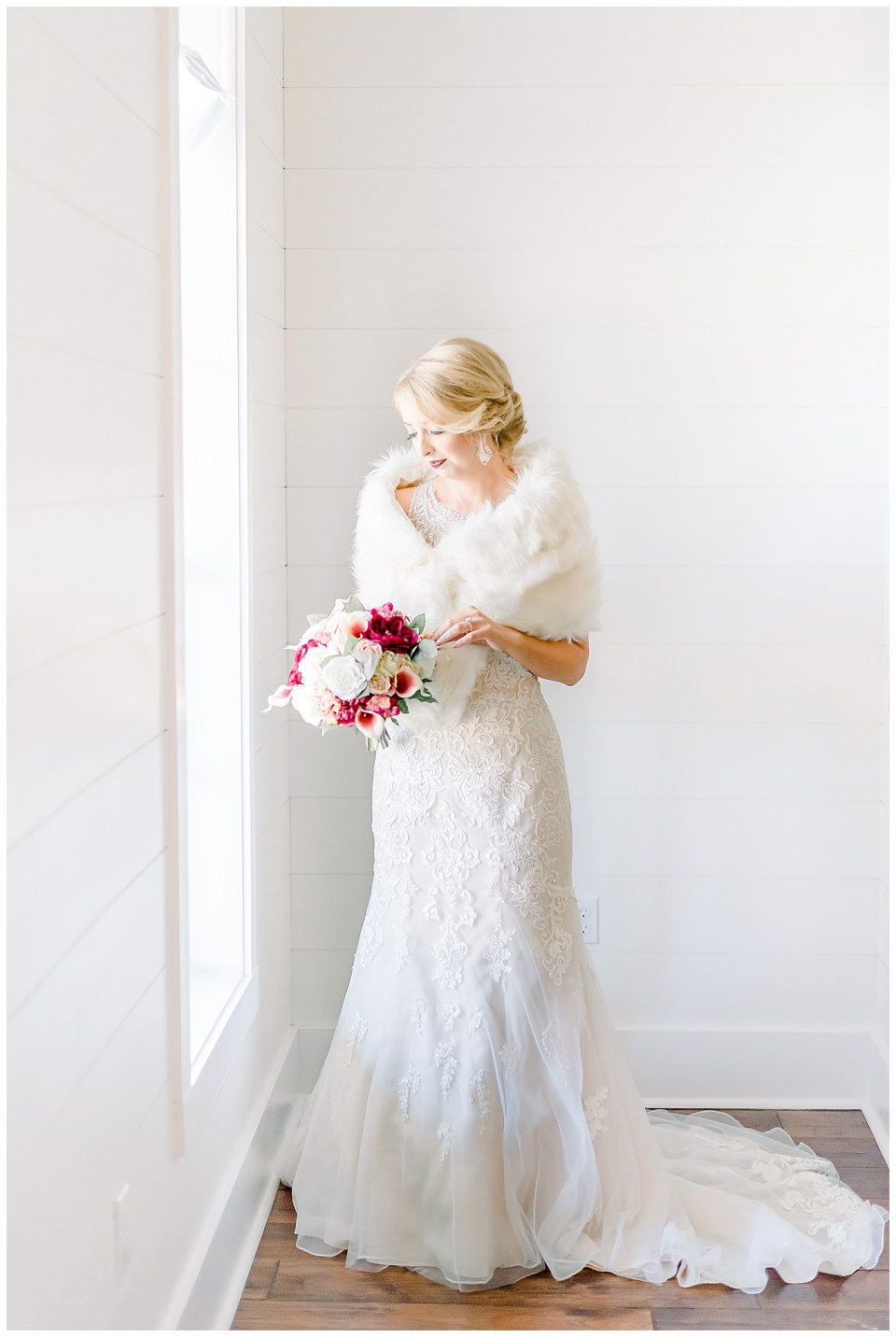bride in front of a window on wedding day