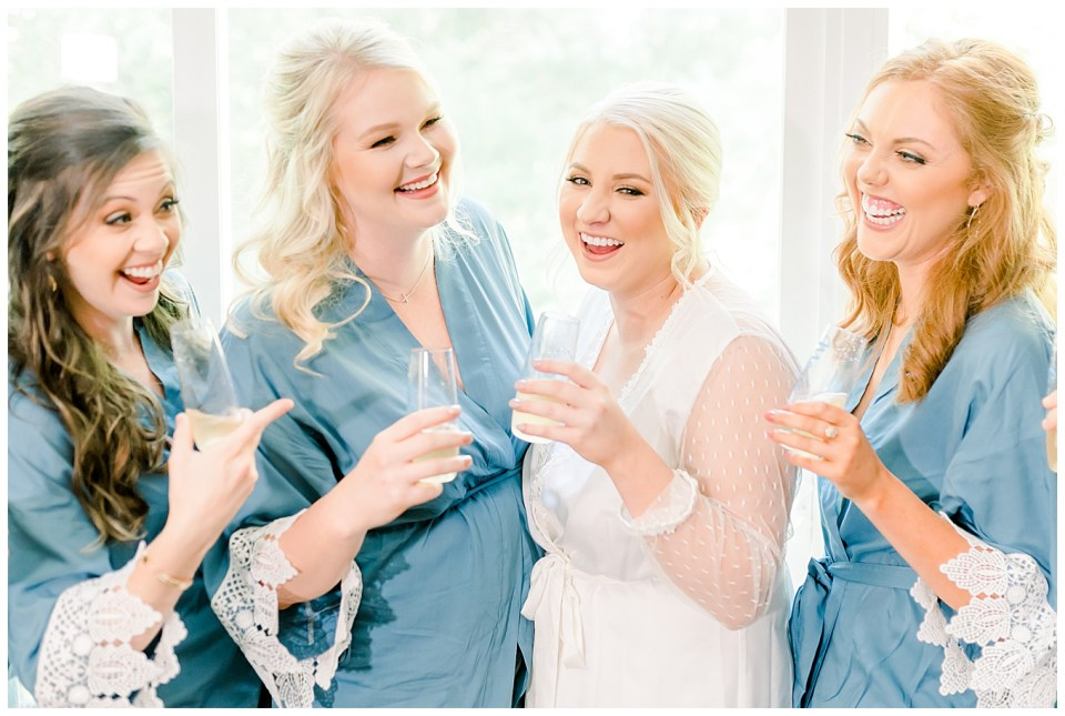 bride sharing a laugh with bridesmaids