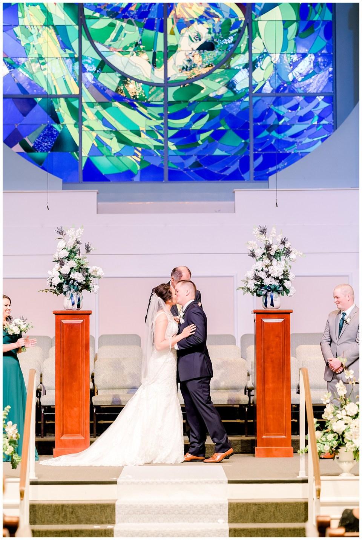 louisiana bride and groom share their first kiss