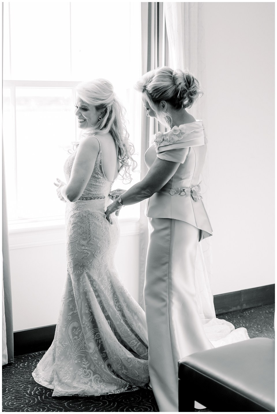 mom and bride getting ready on wedding day