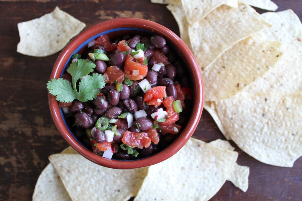 Healthy Black Bean Salsa uses a few pantry ingredients and a few fresh ingredients to make a spiced salsa with a surprise crunch! {Brittany's Pantry}