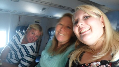 dad, mom, and I on the plane to New York