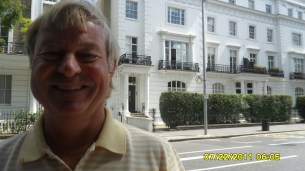 dad in front of his flat