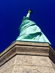 looking up at the Statue of Liberty