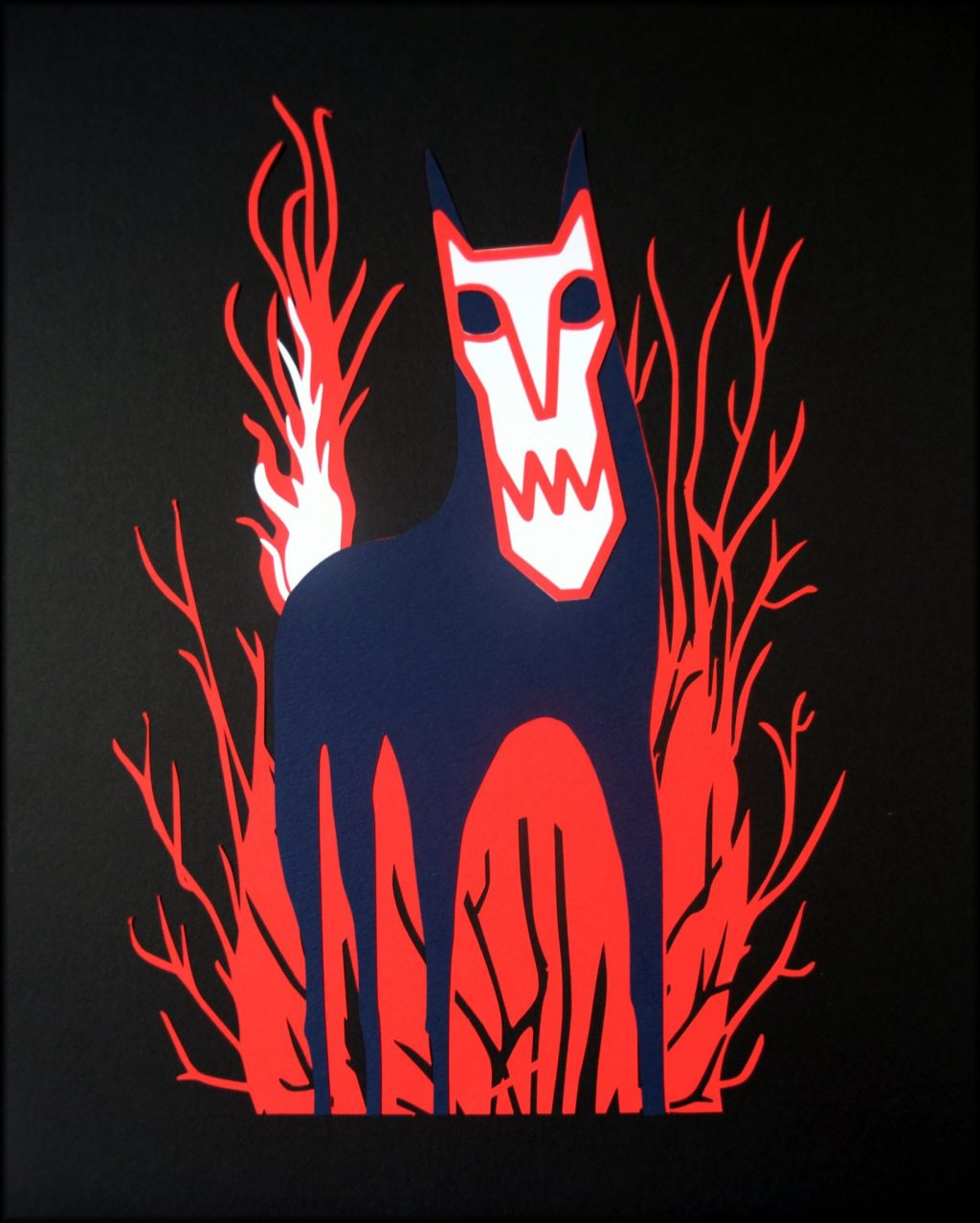 Paper cut art of The Wolf from the Red Riding Hood story. The wolf appears to be wearing a mask and is standing against a background of a forest.