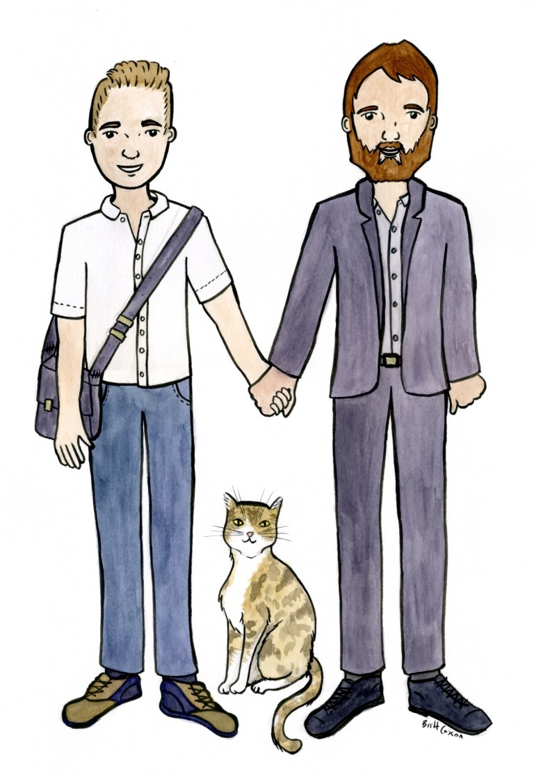 A portrait of a couple holding hands, their cat sits between them.